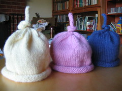 Three hats (Rachel Holkner) Tags: pink blue baby hat yellow knit craft imadethis beanie knitty umbilicalhat