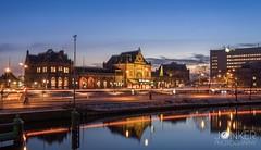 Trainstation Groningen  (melvinjonker) Tags: reflection sony citylights lights city urban cityscape landscape sky sunset sun contrast ergaatnietsbovengroningen holland groningen leefilter longexposure building station trainstation train