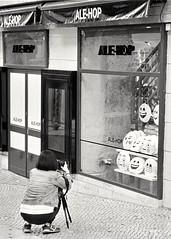 😃😊😘😉😐😐😀😬 (czuerbig) Tags: bairroalto iso100 kodakhc110 kodaktmax100 leicam6 lissabon summicron5020 50mm woman photography street streetphotography shop emoticons