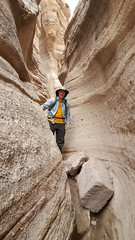 Fredo hiking through the narrow slots in the canyon