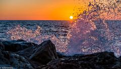 Sunrise on the rocks (xelemendez) Tags: amanecer málaga rompeolas malagueta