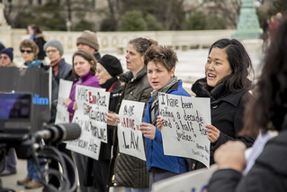 Protesters Sing Outside the Ziglar v. Abbasi Hearing at the U.S. Supreme Court