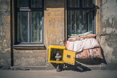 feels like home [explore] (realnasty) Tags: street building window flat sheets bedding bedclothes pillow cushion curtain shabby pipe m43 mft microfourthirds prime lodz poland olympus omd
