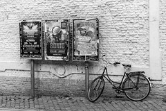Intensss (eric.benoit@35mm) Tags: white black bike wall maastricht pavement events sidewalk posters mur panneau trottoir annonces publicits vnements
