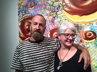 Artist Kenny Scharf with Victoria Rogers, VP of arts at the Knight foundation at Snitzer Gallery