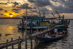 Boats on the river front as the sun went down (tatlmt) Tags: river boats asia cambodia ships tidal kohkong strungkohpoi