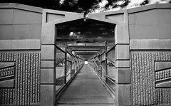 Bridge to Heaven's Gate (Blue Rave) Tags: bridge arizona sky blackandwhite bw phoenix wall architecture clouds fence vanishingpoint angle path angles overpass az pathway pedestrianbridge destinationunknown pedestrianwalkway