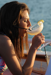 Sipping a Margarita (Poocher7) Tags: ocean gulfofmexico usa florida southwestflorida onboardship sunsetcruise princesssunsetcruise marcoisland bow exoticdrink margarita keylime sunset prettygirl darkhair evening sippingadrink alcohol fun enjoyment