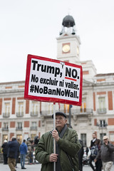 No Trump porta del sol (gianluca_cast) Tags: madrid spain spagna espana palacioreal portadelsol sol real old oldman man abuelo abuelos sign light natural bw color nikon 50mm street streetphotography photojournalism black white blackandwhite winter square monument day d800