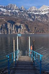 Lake and mountains (Thomas Mülchi) Tags: lakewalenstadt cantonofstgallen switzerland 2017 churfirstenmountainrange lake mountains bluesky snow boatbridge eveninglight quarten sanktgallen ch