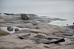 Remains of a rowboat on the island (ilpopaukkeri) Tags: sea finland seaside helsinki raw shore seashore archipelago nikond7000 helsinkiarchipelago