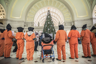 Members of Witness Against Torture Hold a Demonstration in Union Station Near a Christmas Display