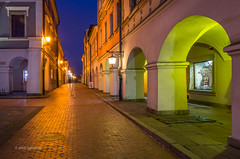 Solna Sreet (pietkagab (on the road)) Tags: zamosc old town poland evening dusk nightfall twilight architecture renaissance street color illumination illuminated walls arches light night nightshot longexposure walk pietkagab photography piotrgaborek pentax pentaxk5ii travel trip tourism sightseeing unesco site europe