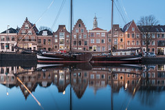 Mirrored (McQuaide Photography) Tags: haarlem noordholland northholland netherlands nederland holland dutch europe sony a7rii ilce7rm2 alpha mirrorless 1635mm sonyzeiss zeiss variotessar fullframe mcquaidephotography lightroom adobe photoshop tripod manfrotto light licht bluehour twilight schemering water reflection stad city urban waterside lowlight architecture outdoor outside waterfront building longexposure winter river spaarne donkerespaarne riverside pegasus boat ship schip boot zeilboot sailboat traditional authentic wideangle groothoek skyline house residential