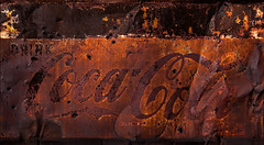Refocillation (Junkstock) Tags: aged abandoned artifact artifacts arizona altebenutztegegenstände americana advertisement advertising coke cocacola corrosion corroded decay decayed distressed goldfield graphics graphic oldusedobjects oldstuff relic rust rusty rusted sign signage signs textures texture typography type weathered