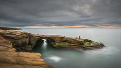 Front Row Seats (David Colombo Photography) Tags: sandiego sunset sunsetcliffs arch rock sandstone pacific ocean lowtide clouds longexposure water sky landscape grey green turquoise color nikon d800 davidcolombo davidcolombophotography serene sea outdoor peaceful calm