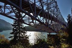 Bridge of the Gods and Columbia River (thor_mark ) Tags: beams blueskies bridge bridgecolumns bridgecrossing bridgestructure bridgeofthegods canvas capturenx2edited cascaderange colorefexpro columbiagorgenorth columbiariver columbiarivergorge columbiarivergorgenationalscenicarea day7 girders historiccolumbiariverhighway historiccolumbiariverhighwayscenicbyway lookingwest miscellaneous mounthoodarea nikond800e oregoncascades pacificranges portfolio project365 river southwashingtoncascades steeltrusscantileverbridge travel triptomountrainierandcolumbiarivergorge trusses usroute30 cascadelocks or unitedstates