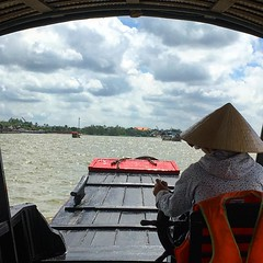 On the Mekong (ToGa Wanderings) Tags: water open front view asia culture lifestyle movement sailing driving floating hat vietnamese vietnam river driver boat tourism tour delta mekong instagramapp square squareformat iphoneography