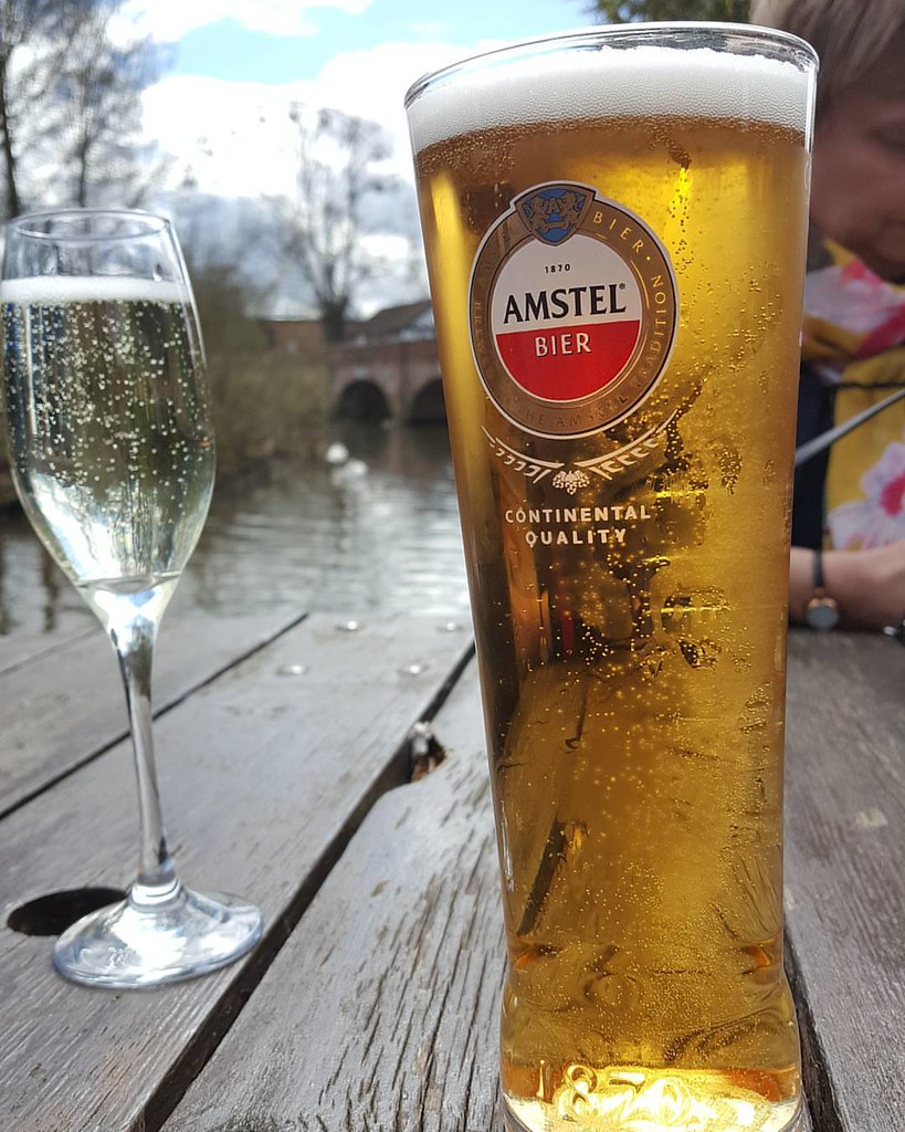 a lovely day to be sat by the river enjoying a pint amstel prosecco - Andys Kitchen