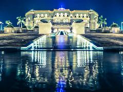 Emirates Palace (tiagocsta) Tags: water night flag united towers palace emirates arab abu dhabi etihad