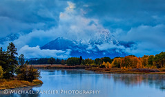 Mt. Moran Shrouded in Clouds at Sunrise (Michael Pancier Photography) Tags: autumn mountains fall nature water landscape us unitedstates outdoor moose jackson snakeriver serene wyoming mountmoran nationalparks americathebeautiful jacksonhole fineartphotography tetonrange naturephotography grandtetonnationalpark americansouthwest travelphotography commercialphotography oxbowbend naturephotographer editorialphotography michaelpancier michaelpancierphotography landscapephotographer fineartphotographer nationalparkphotography michaelapancier americasnationalparks wwwmichaelpancierphotographycom fallinthenationalparks