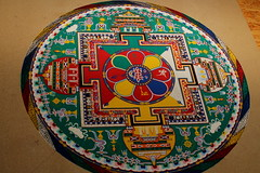 sand mandala (Etching Stone) Tags: ocean life china wood west art geometric water composition blessings flow death three sketch sand meditate floor image path robe south north ceremony craft compassion monk buddhism indoor lastday center mandala palace tibet east mind change ritual balance karma wisdom enlightenment humanrights healing dharma brass karlsruhe liberation sweep tool beings bardo deities refuge individual destroy serve animalright  construct guiding dimensional purification completion sentient schlachthof avalokiteshvara chenresig consecrated reside embody tollhaus