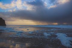 sun behind the storm (j j miller) Tags: ocean california ca sunset storm reflection beach rain clouds coast dusk lowtide cloudporn hwy1 californiacoast pomponio statebeach pomponiostatebeach