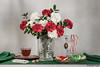 Still life with Christmas flowers. (Phyllis Freels) Tags: christmas phyllisfreels white candycane carnations cookies flowers green holiday holly indoor ornament peppermint red stilllife tabletop tea vase