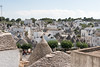 IMG_7099 (jaglazier) Tags: 2016 73116 alberobello apulia architecture buildings chimneys cityscapes copyright2016jamesaglazier deciduoustrees domes hills houses italy july roads roofs stackedstone trees trulli urbanism vaults cities clouds panorama stonebuildings streets unescoworldheritagesites whitewash puglia