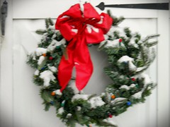 Snowy wreath (Maenette1) Tags: snow wreath red bow christmas menominee uppermichigan flicker365 nikoncoolpixl22camera