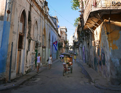 Comings and goings (steverichard) Tags: street calle havana lahabana city ciudad life people rickshaw flag cuban cuba decay buildings travel photo foto image steverichard pedestrians bicitaxi oldhavana vieja