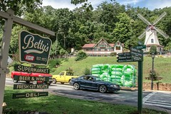 Betty's IGA  Supermarket Ole Country Store ..... (~ Cindy~) Tags: place bettys iga 1973 street main truck yellow red car sports store country georgia helen windmill alpine hww htt floats green spring 2015