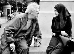 Cultural Exchange  [Explored # 374] (jaykay72) Tags: street uk blackandwhite bw london candid hijab streetphotography trafalgarsquare londonist stphotographia