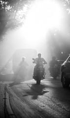 Hyderabad_20150922_012 (Georg Dombrowski) Tags: life people blackandwhite bw india man backlight menschen motorbike mann dust hyderabad schwarzweiss indien gegenlicht motorrad in swsw staub streetphotograhy telangana hydraba