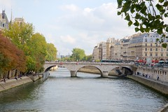 Seine at Pont au Change (Herculeus.) Tags: travel trees people paris france architecture clouds buildings river landscape outside outdoors oct bridges adults residential 2015 5photosaday pontauchange archtypebridges seinefrance sfhomes aptcondo bridgesovertheseineinparis paristonormandyfrance15