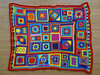 The afghan that eluded me after the last end was woven in (crochetbug13) Tags: crochet crocheted crocheting afghan crochetafghan blanket crochetblanket grannysquare crochetgrannysquare grannysquares grannysquaresampler