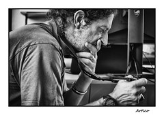 How the heck does it work ...??? (Artico7) Tags: colleage man camera fujifilm studying absorbed concentrated rocker davide pavan neophyte rookie bw person e nero monochrome fuji xe1 portrait hand meditating meditation blackwhite blackandwhite biancoenero