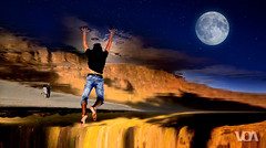 Fly me to the Moon (El Orfebre Mochilero) Tags: moon sky night stars fly dive oniric dream scape freedom guy young boy beach landscape mountains cliffs rocks shore water barefoot clouds red orange fall jump reflection jeans tshirt couple upsidedown lanzarote famara canary islands