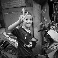 Fly Emirates:  Explored 2.6.2017 (michael.veltman) Tags: peace project boy portrait jakarta indonesia