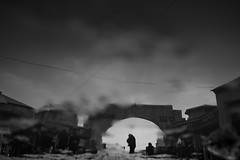 Entering Osh Bazaar (maekke) Tags: kyrgyzstan bishkek reflection puddlegram bw noiretblanc silhouette humanelement market kirgistan travelling tourist fujifilm x100t 35mm 2017 urban streetphotography osh bazaar oshbazaar