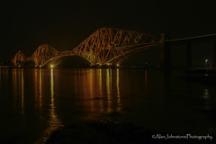 The Night Train (ajp~) Tags: forthrailbridge forthbridge southqueensferry scotland firthofforth water sea reflections landscape longexposure night lights bridge train railway rocks hawespier pier canon 6d canon24105mmf4l canon1740mmf4l alanjohnstone