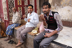 Drinking chai (Dick Verton ( more than 13.000.000 visitors )) Tags: travel people india men asia sitting drinking streetphotography sit varanasi seated chai streetshot