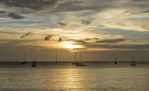 Sunset with yachts and catamarans at Nai Harn beach, Phuket, Thailand