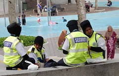 Secure Women (mikecogh) Tags: kualalumpur kl klcc klccpark muslim culture custom women covered security vests hiviz occupation job workers