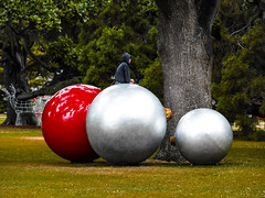 The Balls They Drove Me Mad (Steve Taylor (Photography)) Tags: xmas christmas baubels balls reindeer wireframe red silver art sculpture animal green boy child newzealand nz southisland canterbury christchurch hagleypark summer deer