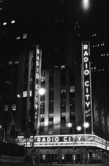 radio city 4am (MitchBoudreau) Tags: blackandwhite monochrome architecture building city nyc new york newyork newyorkcity radiocity music radiocitymusichall classic film 35mm ilforddelta 50iso night nightphotography nightlights contrast 35mmfilmphotography beautiful iloveny shadows street streetphotography usa
