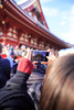 Young woman taking pictures of people on stage (Apricot Cafe) Tags: img628703 asakusa asianethnicity canonef1635mmf28liiusm japan japaneseethnicity japaneseculture setsubun setsubune tokyo beanthrowingceremony daytime girl happiness holiday joyful mamemaki nostalgic oneperson onlywomen outdoor people smile street sunlight traditional traditionaljapan walking winter woman youngadult taitōku tōkyōto jp