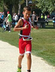 Giving everything (Cavabienmerci) Tags: kids triathlon 2016 yverdon les bains switzerland suisse schweiz kid child children boy boys run race runner runners lauf laufen läufer course à pied sport sports running triathlete