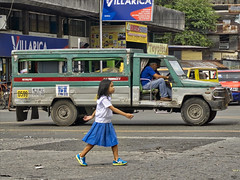 Crossing (Beegee49) Tags: young girl determined marching striding jeepney street bacolod city philippines
