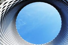 Hole (Rosmarie Voegtli) Tags: hole loch sky himmel architecture grid netz flechtwerk neuemessebasel herzogdemeuron kunst art architektur kreis